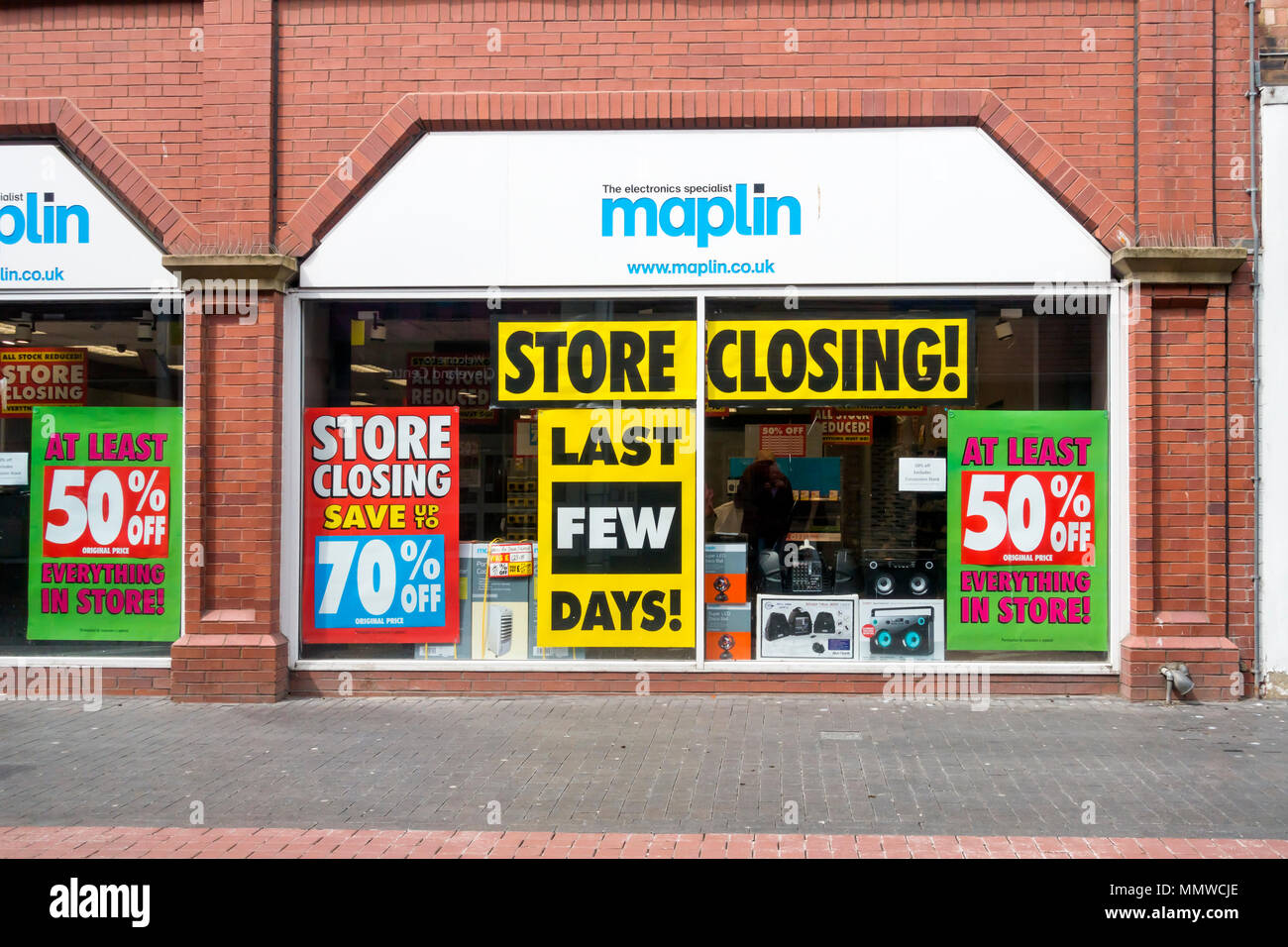 Maplin electronic equipment sale shop front with closure sale notices due to the company going into administration May 2018 - Stock Image