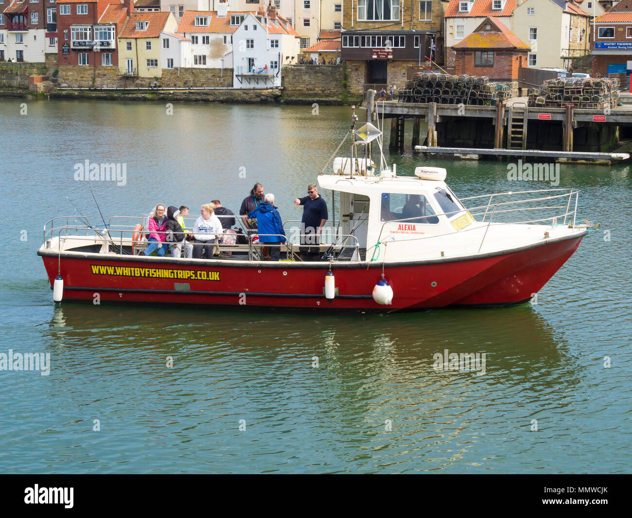 'Alexia' a fishing boat providing sea fishing trips for anglers arriving back in Whitby harbour - Stock Image