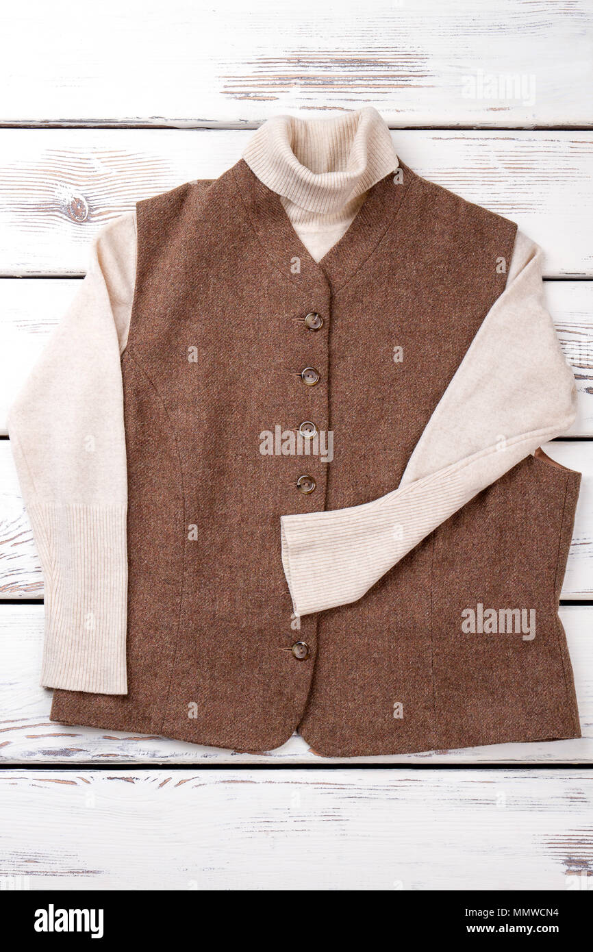 Female brown vest and white sweater. - Stock Image