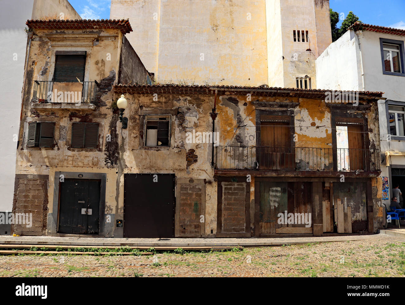 Fading buildings showing their age near Largo Pelourinho Funchal on Madeira - Stock Image