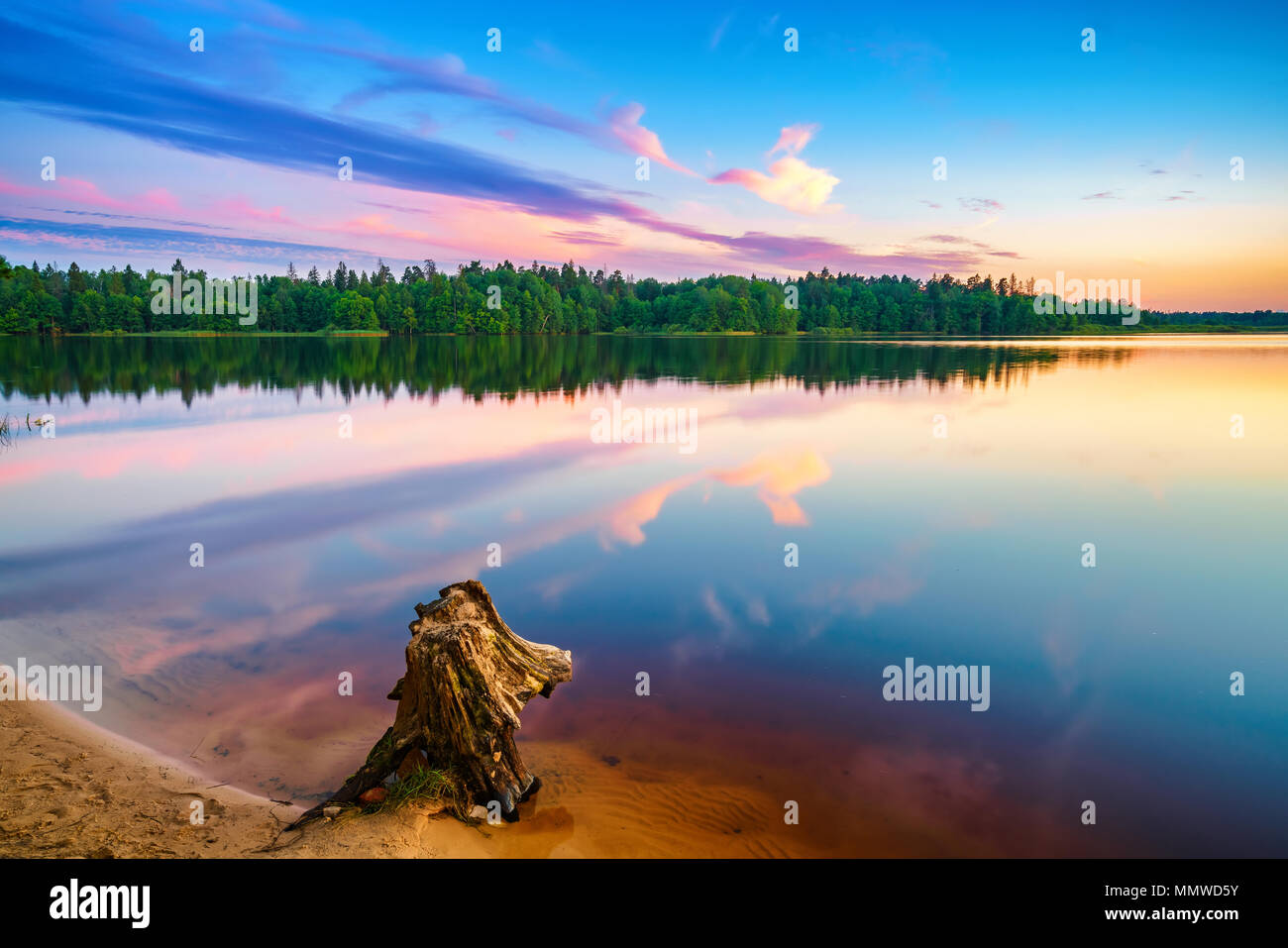 Bright sunset on a lake - Stock Image