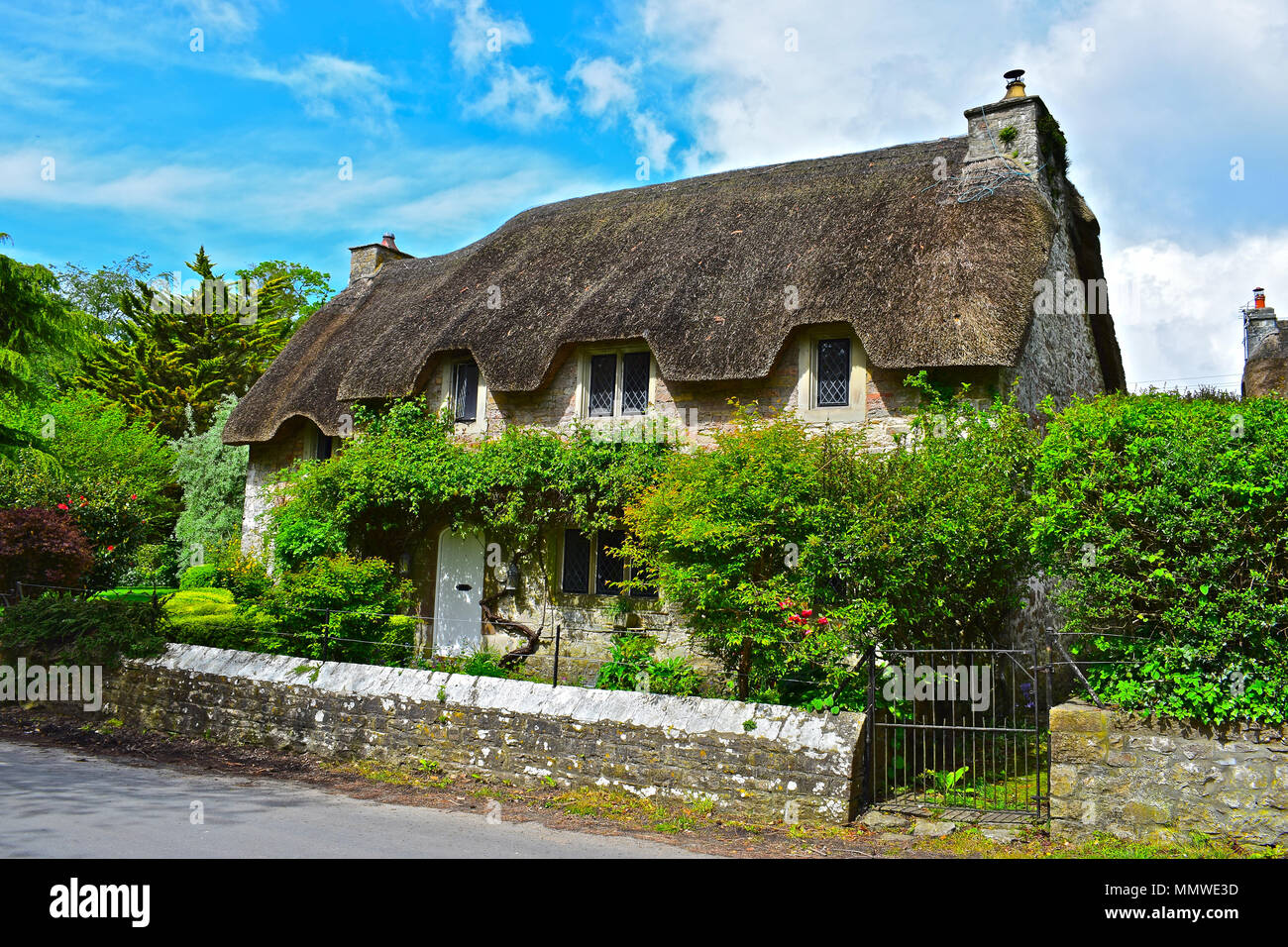 The Pretty Thatched Roof House Known As Church Cottage In The