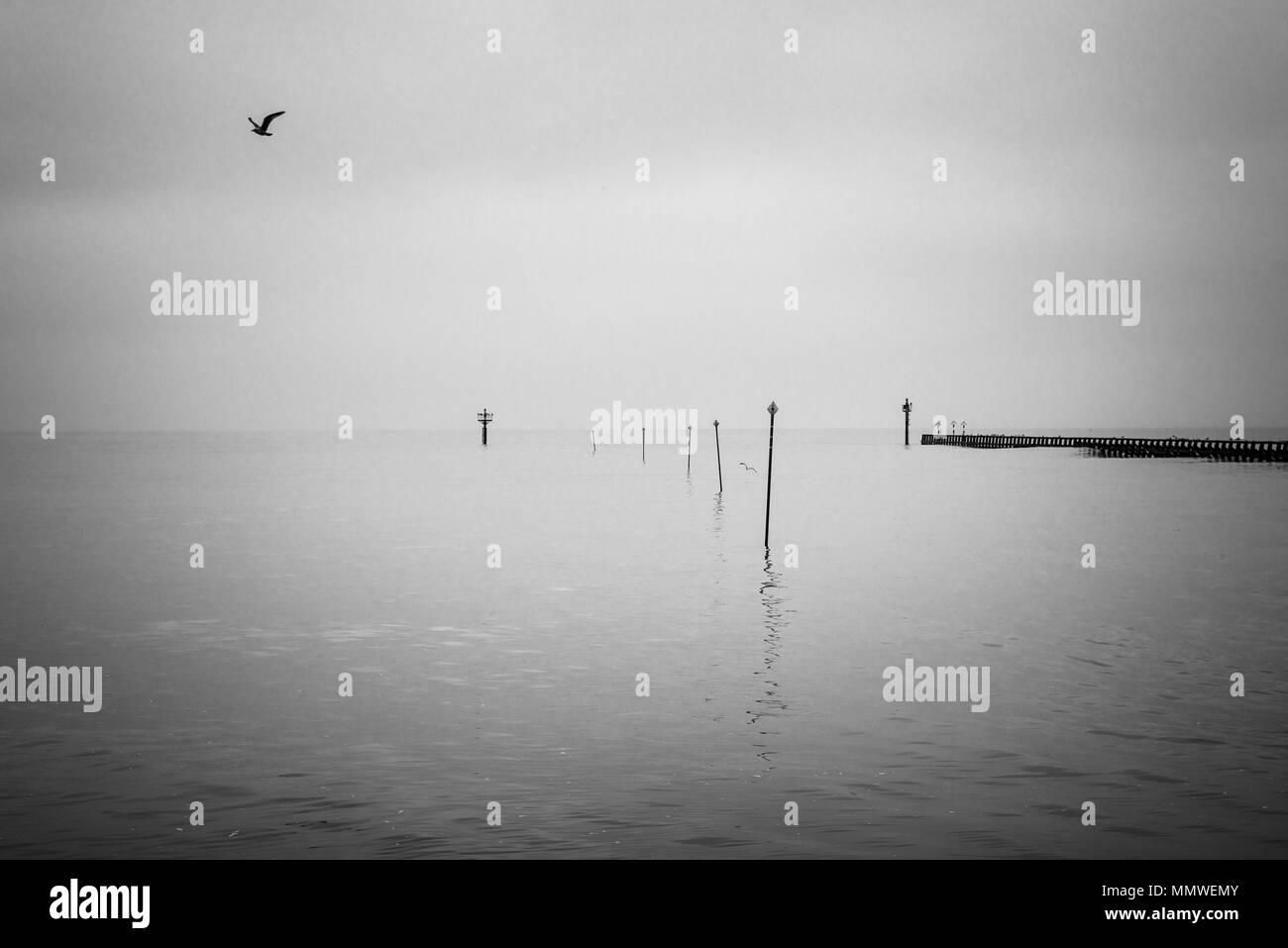 A misty overcast day on the beach at Littleampton in West Sussex, England. - Stock Image