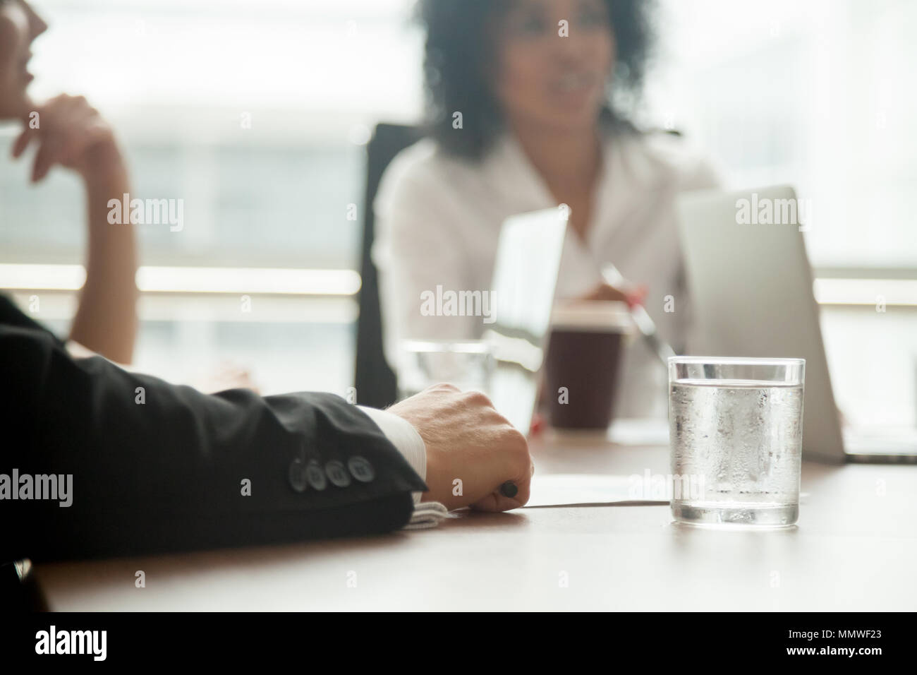 Businessman in suit participating group meeting or negotiations, Stock Photo