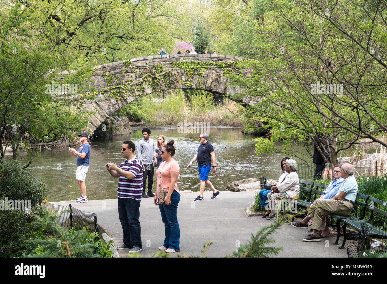 Gapstow Bridge and the pond are a popular location in Central Park, NYC, USA Stock Photo