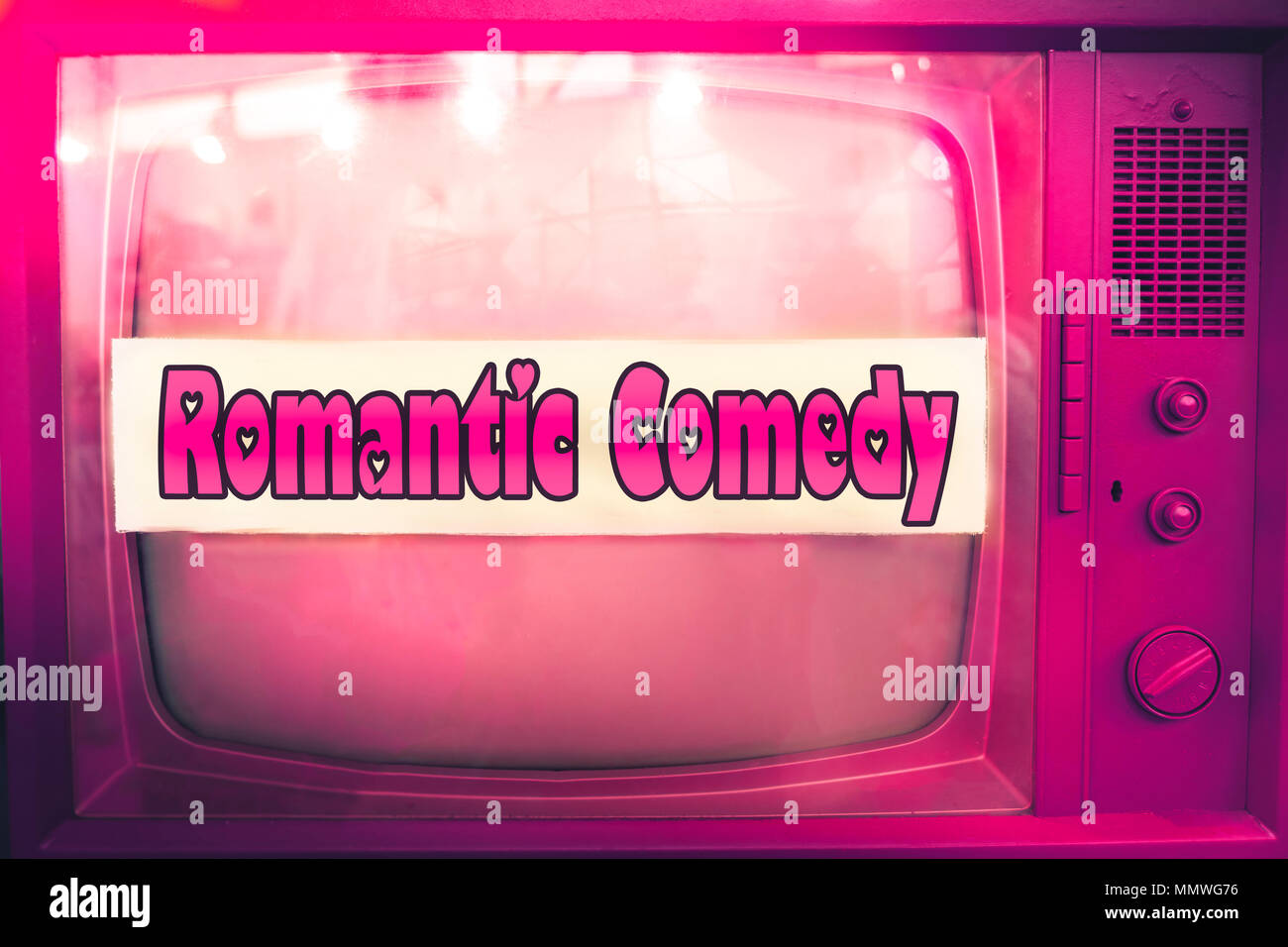 romantic comedy pink tv film genre purple television label old tv text vintage retro romance movie background - Stock Image