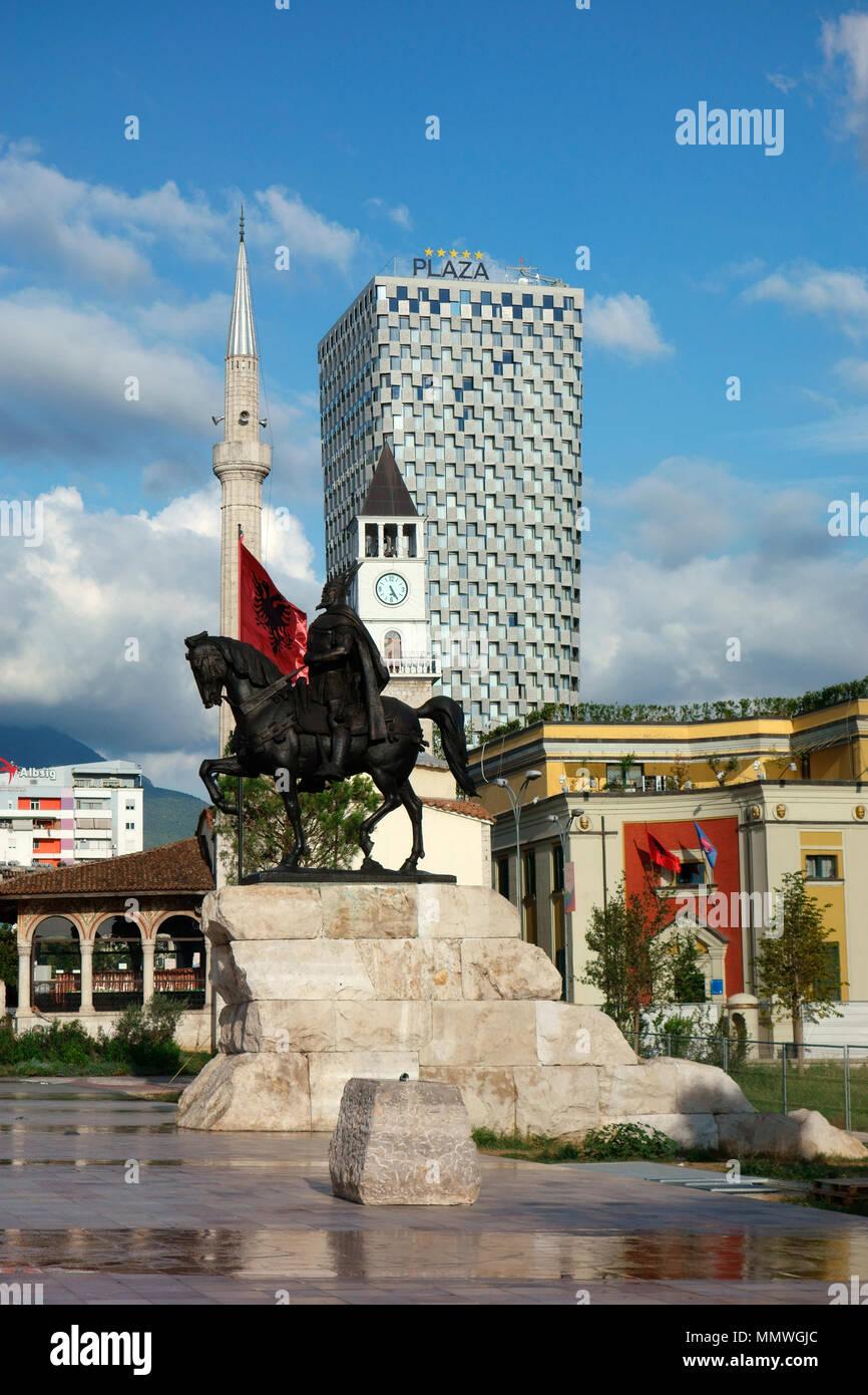 The Skanderbeg Monument and Et'hem Bey Mosque on Skanderbeg Square in Tirana, Albania, Balkans - Stock Image