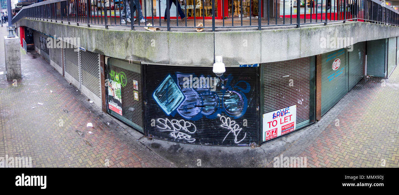 Shuttered up shop units in a walkway in Birmingham city centre, West Midlands, UK - Stock Image