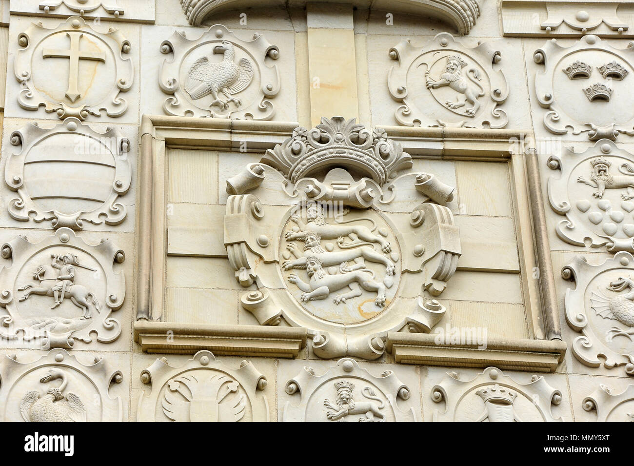 Close up of the Danish coat of arms above the gate at Frederiksborg Castle, Hillerod, Denmark. Beautiful detail, three lions below a crown, - Stock Image