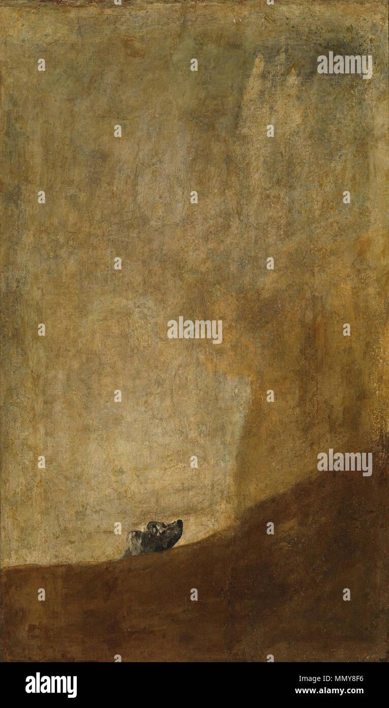 English: The Dog Français: Le Chien Türkçe: Bir Köpek ?spanyol sanatç? Francisco Goya taraf?ndan yap?lm?? ve Madrid'deki Prado Müzesi'nde bulunan tablodur. Sanatç?n?n Kara Resimlerinden birisi olan tablo, 1819 ile 1823 tarihleri aras?nda ald??? evin duvarlar?na dekorasyon amaçl? çizilmi? ve 1873 y?l?nda Frédéric Émile d'Erlanger emriyle, Salvador Martínez Cubells taraf?ndan tuvale aktar?lm??t?r. between 1820 and 1823. Goya Dog - Stock Image