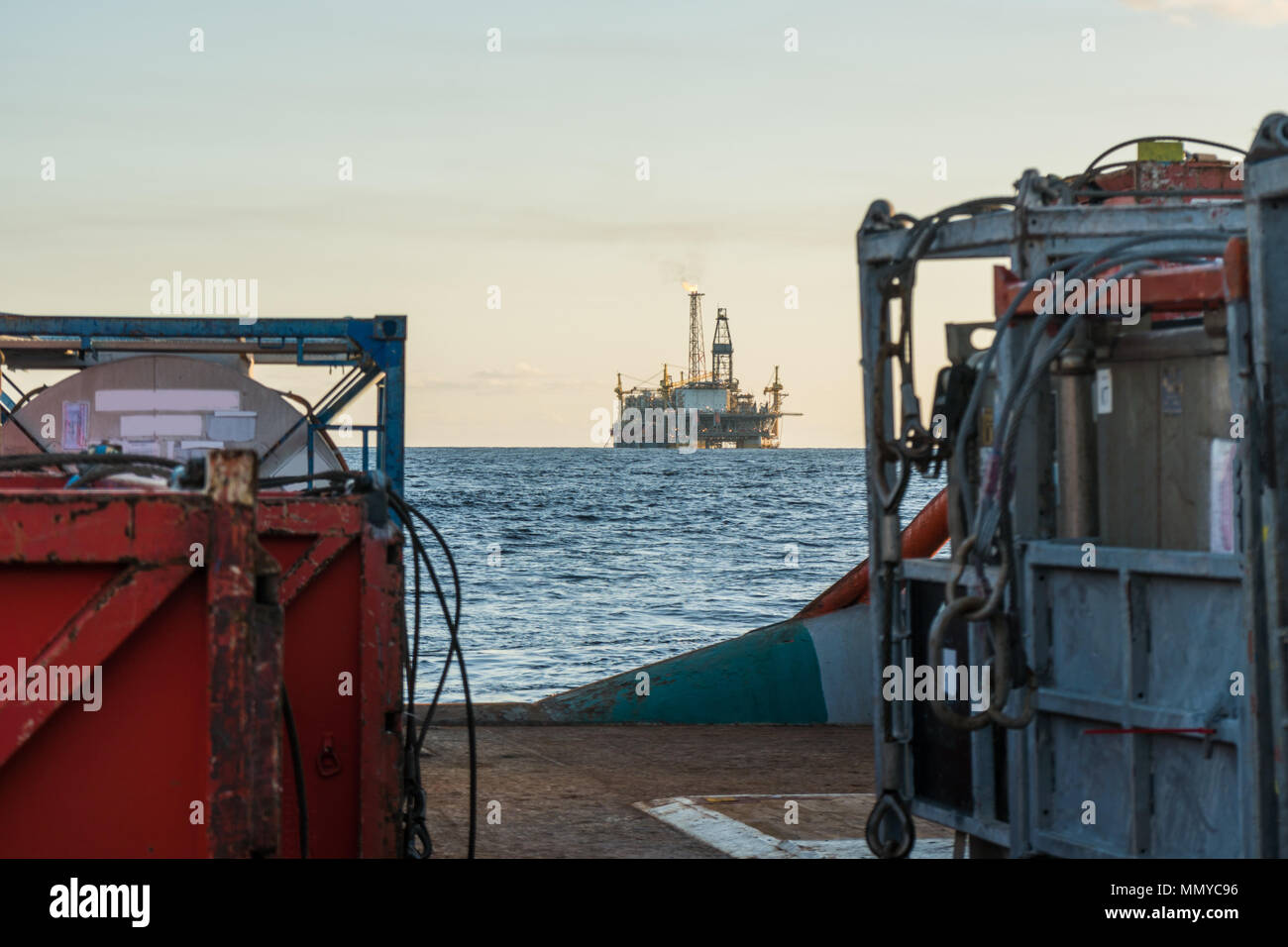 offshore supply boat with containers and tanks onboard