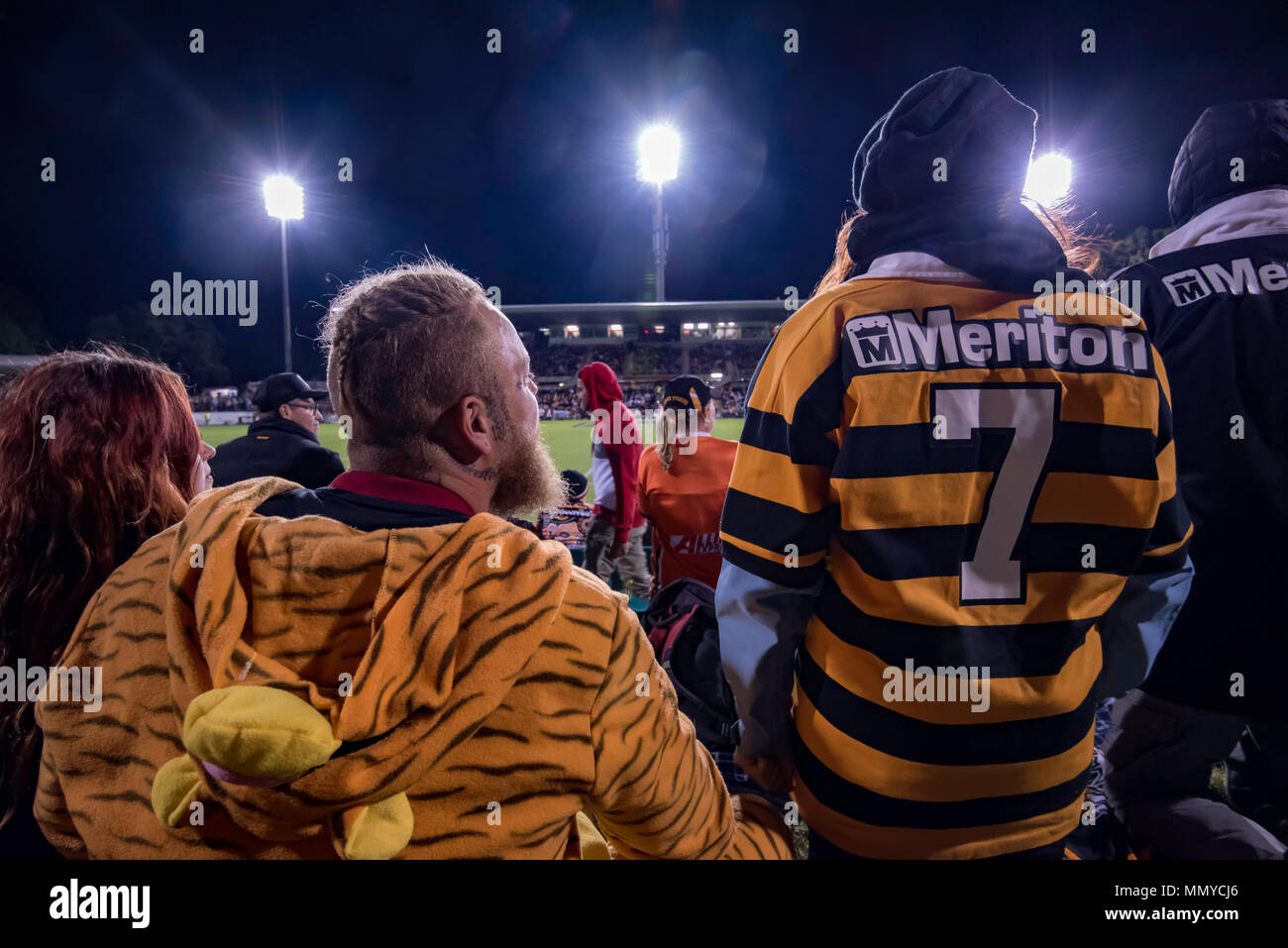 Rugby League supporters at the Sydney based Wests Tigers v North Queensland Cowboys game at Sydney's Leichhardt Oval on May 10th, 2018 in Australia Stock Photo