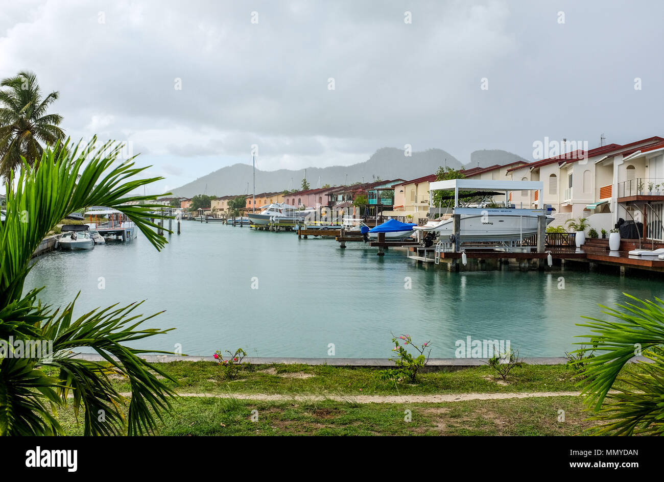Antigua Lesser Antilles islands in the Caribbean West Indies - Holiday homes and jetties at the Jolly Harbour complex - Stock Image
