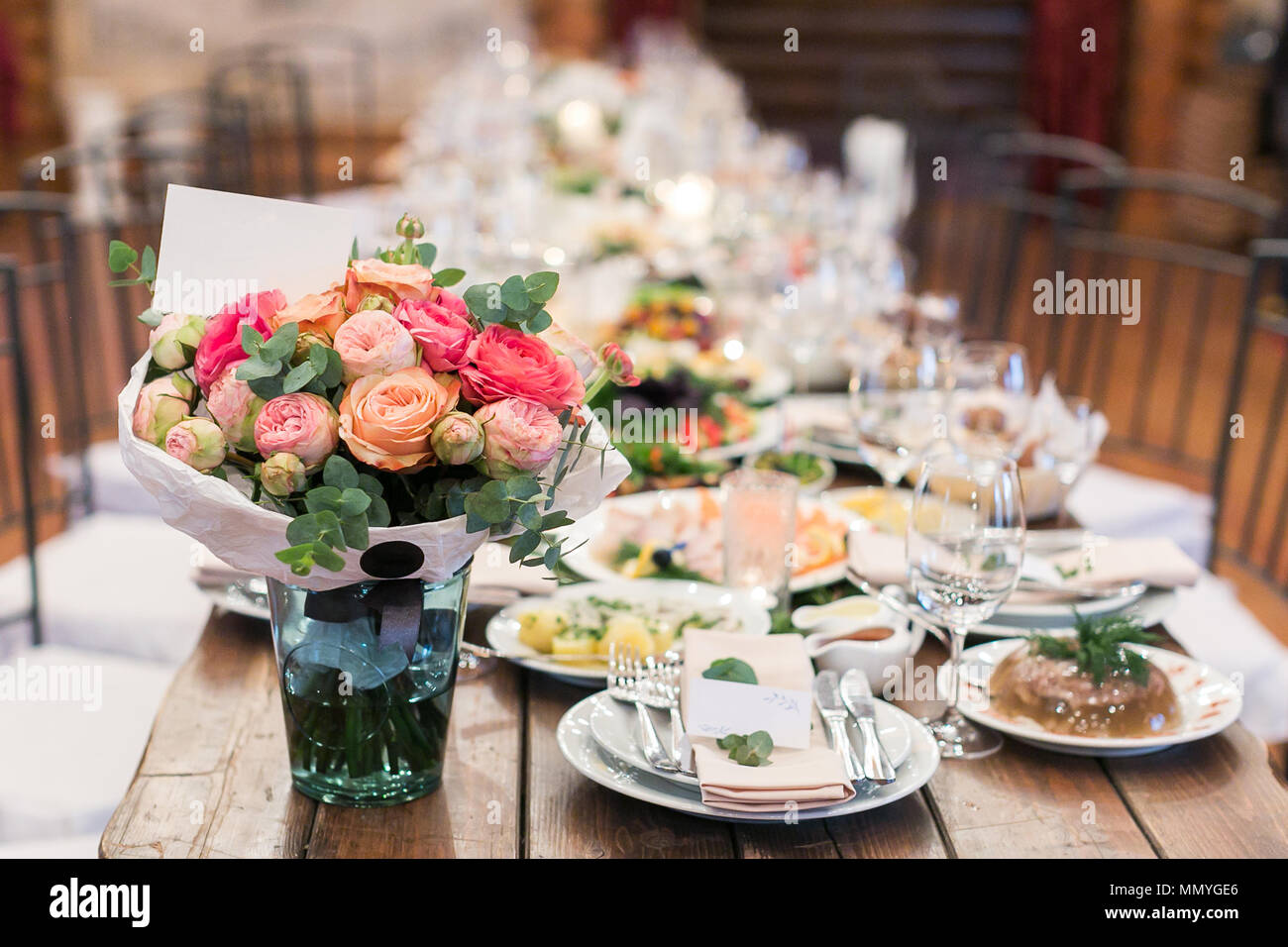 food, nature, decor concept. there is a still nature composed of marvelous bouquet of roses and peonies and amount of dishes with different treats suc Stock Photo