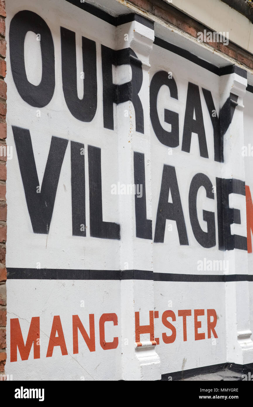 Our Gay village Manchester, painted on a wall - Stock Image