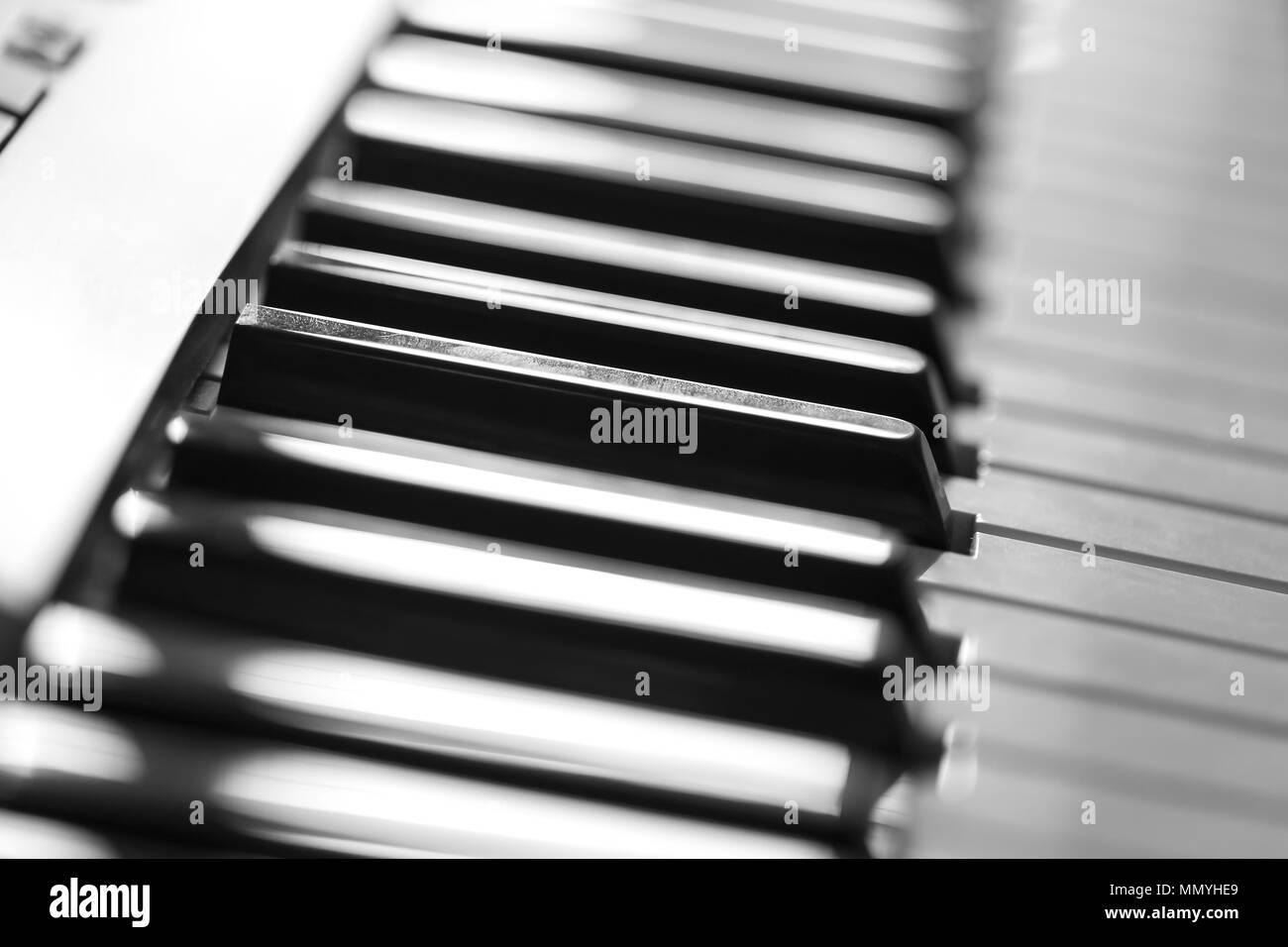 Keys of the electronic synthesizer close-up. Black and white photography - Stock Image