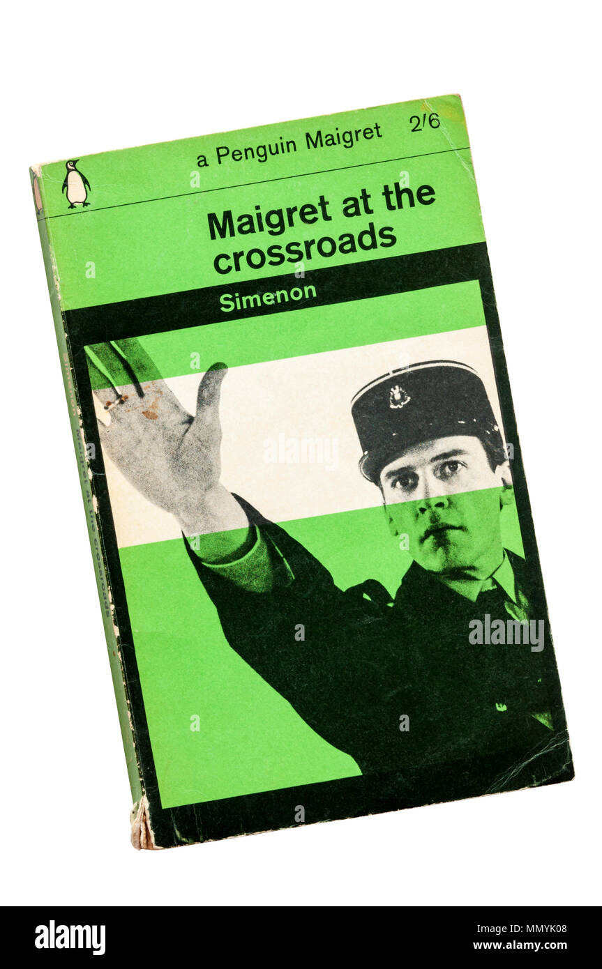 Green Penguin Maigret published 1963. Maigret at the Crossroads first published in French as La Nuit du Carrefour in 1931. - Stock Image