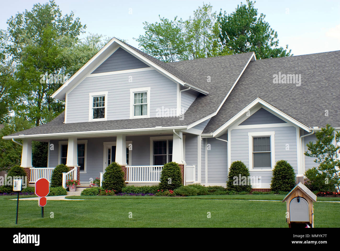 Beautiful New Country Style Wood Home Featuring A Large Front