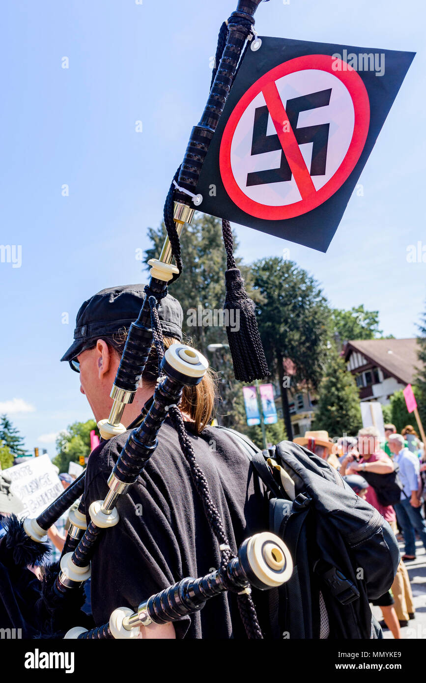 Bagpiper with no Nazi's sign at Anti-Racism Rally, City Hall, Vancouver, British Columbia, Canada. - Stock Image