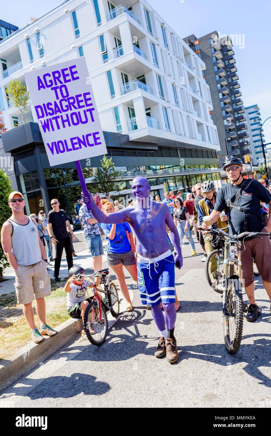 Purple man at Anti-Racism Rally, City Hall, Vancouver, British Columbia, Canada. - Stock Image
