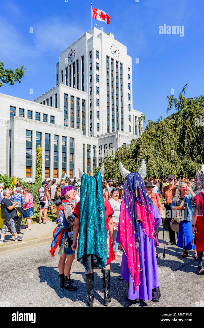 Strangely dressed group with horns at Anti-Racism Rally, City Hall, Vancouver, British Columbia, Canada. - Stock Image