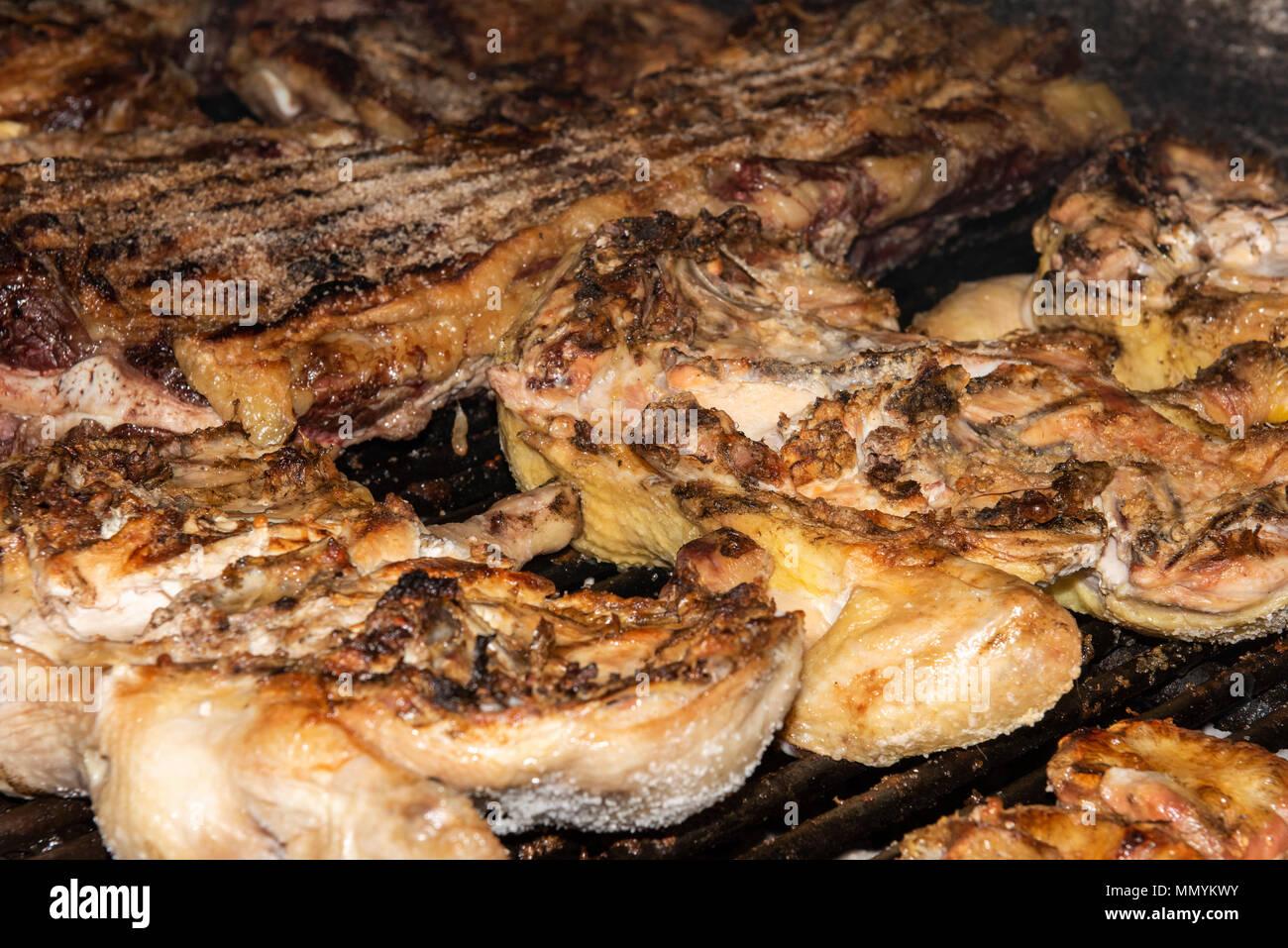 Argentina, Pampas, San Antonio de Areco. Traditional estancia, El Ombu de Areco. Typical gaucho chicken & steak BBQ lunch. - Stock Image