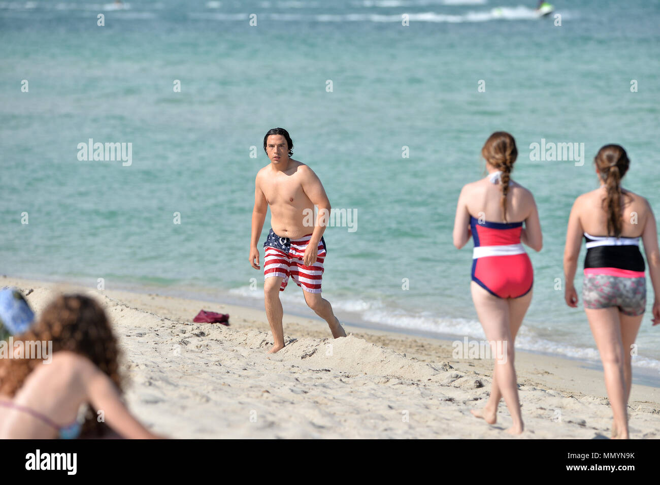 05e011b18a MIAMI BEACH, FL - MAY 14: Actor Jon Bass goes for a swim wearing American  Flag bathing suit at his South Beach Hotel on Mother's Day on May 14, ...