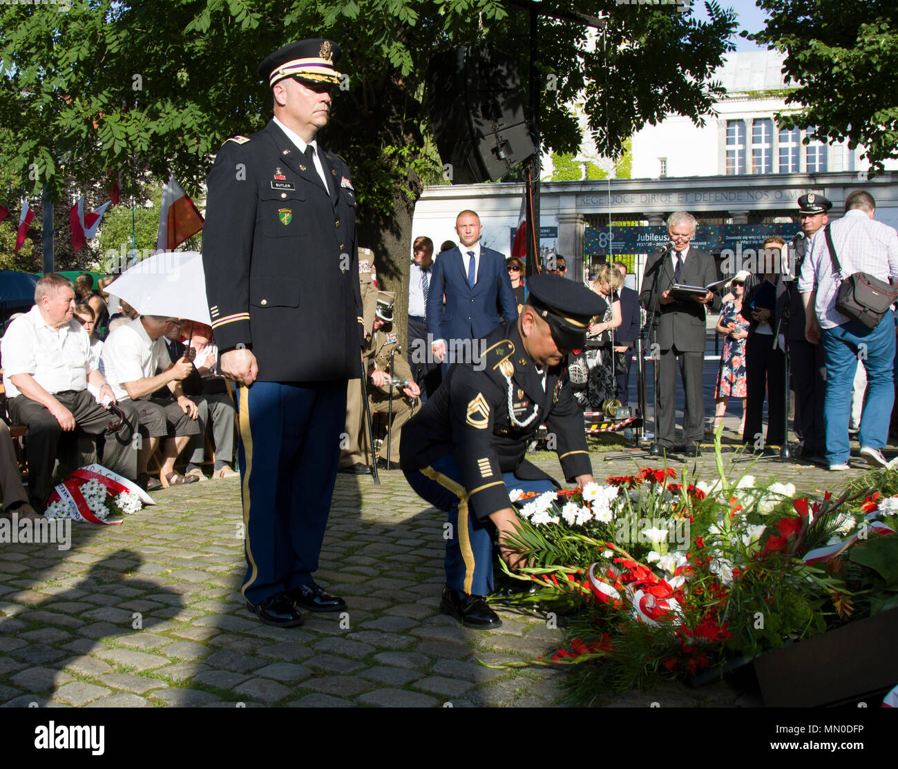POZNAN-Poland – Sgt. 1st Class David Acosta, noncommissioned-officer-in-charge,  Mission Command Element-Atlantic Resolve lays a wreath honoring those who paid the ultimate sacrifice during the  73rd Annual Warsaw Uprising Ceremony Aug. 1, 2017.  Maj. Michael Butler, civil affairs officer-in-charge, MCE AR and Acosta represented MCE-AR during the commemorative ceremony. The Uprising began Aug. 1, 1944 when the Polish resistance attempted to liberate Warsaw from Nazi Germany in occupied Poland. The uprising lasted for 63 days, ending after a massive retaliation by the Nazis. The MCE, now based  Stock Photo