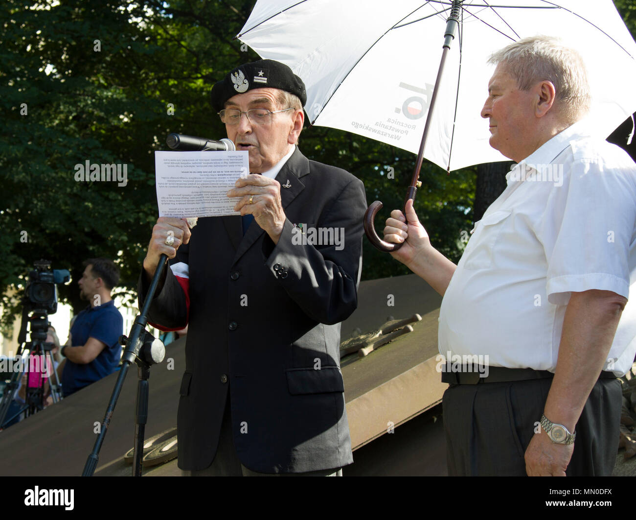 POZNAN-Poland –Maj. Janusz Gunderman, member of the Polish Resistance Home Army or Armia Krajowa, addresses the audience about his experience 73rd annual Warsaw Uprising Ceremony Aug. 1, 2017. The 1944 Warsaw Uprising against the Germans was one last attempt to save Poland's independence during World War II. The uprising lasted for 63 days, ending after a massive retaliation by the Nazis. On invitation from the Polish governor, members of the Mission Command Element-Atlantic Resolve participated in the event. The MCE, now based in Poznan at the invitation of the Polish government as part of ou Stock Photo