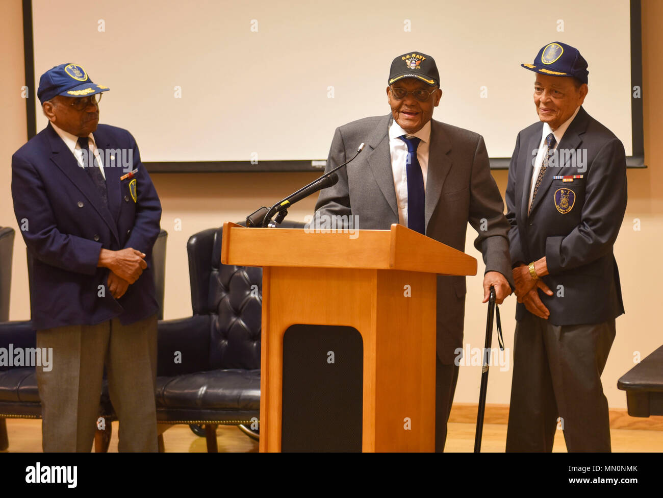 170804-N-VA474-056 WASHINGTON (Aug. 4, 2017) Three of the four surviving veterans of the U.S. Navy B-1 Band gather for a special reunion at the National Museum of the United States Navy to commemorate the 75th anniversary of their enlistment. Veterans Simeon Holloway, Calvin Morrow, and Jewitt L. White joined author Alex Albright to discuss his book, The Forgotten First: B-1 and the Integration of Modern Navy, the band's formation and significance. (U.S. Navy photo by Public Affairs Specialist Monee' Cottman/Released) - Stock Image