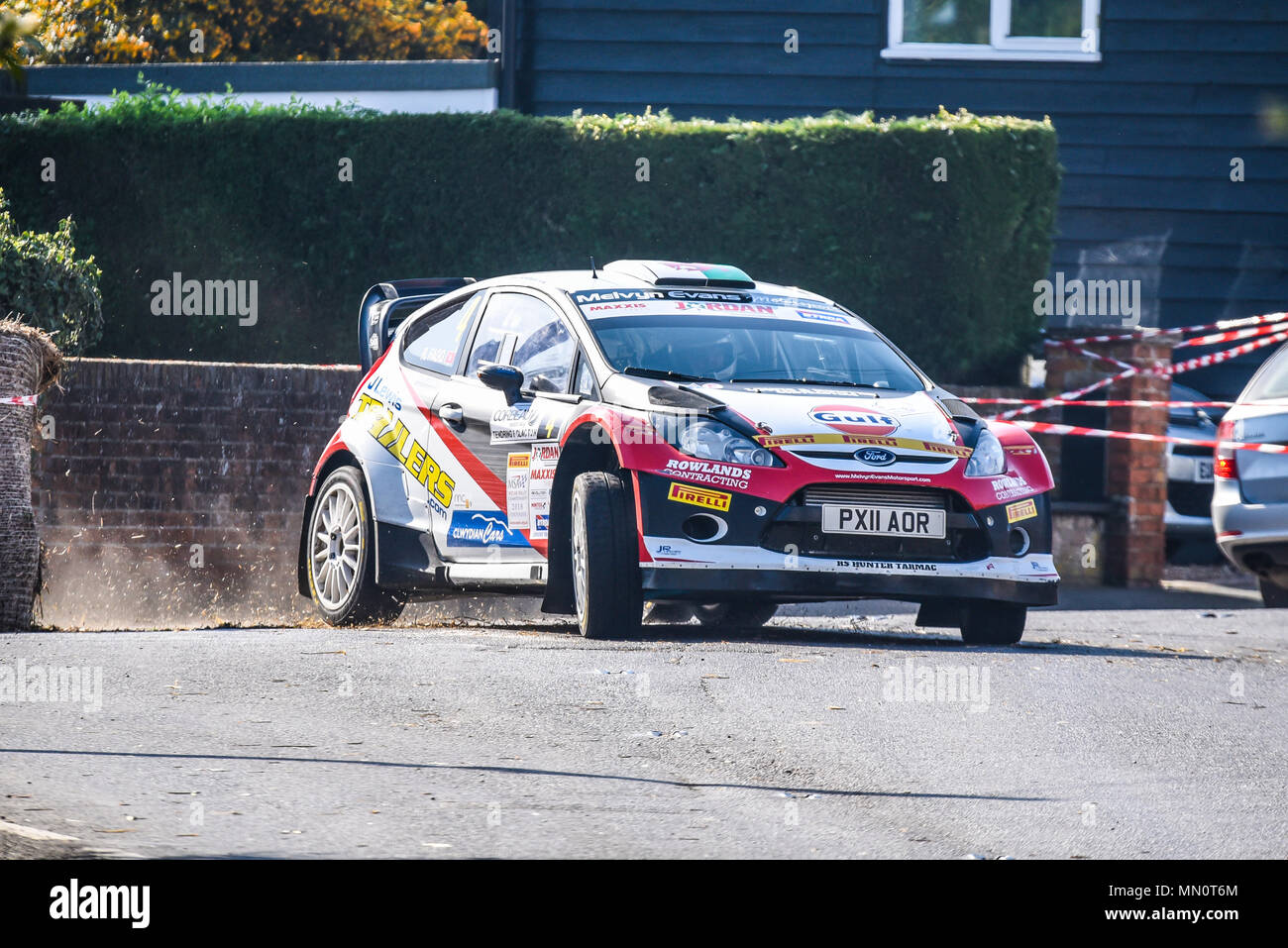 Hugh Hunter driver Rob Flagg co driver racing Ford Fiesta WRC in the closed public road Corbeau Seats car Rally Tendring and Clacton, Essex, UK - Stock Image