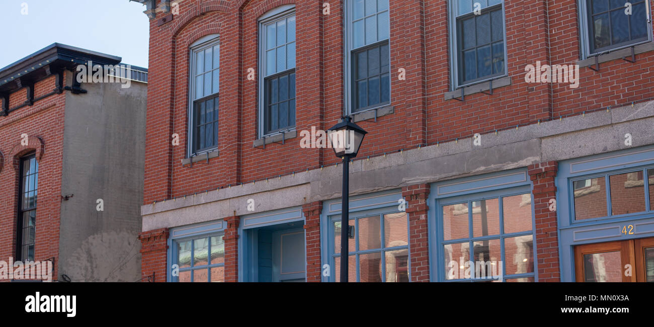 image of building in the old wharf section of Portland Maine - Stock Image