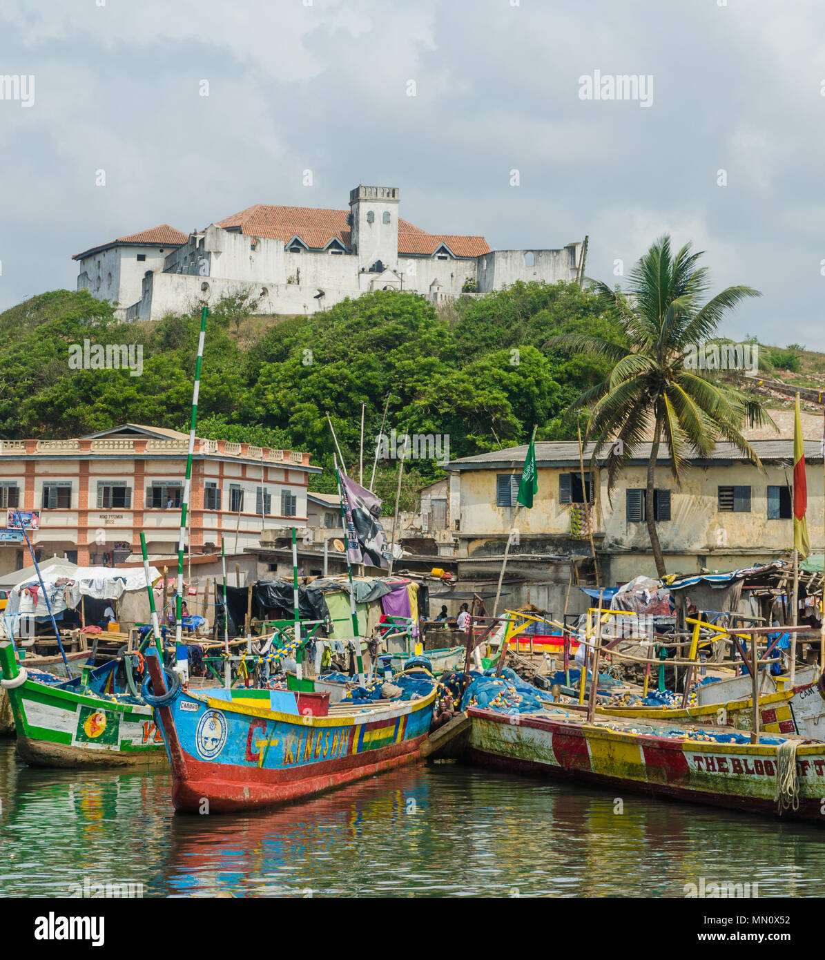 Elmina, Ghana - February 13, 2014: Colorful moored wooden fishing boats in African harbor town Elmina - Stock Image