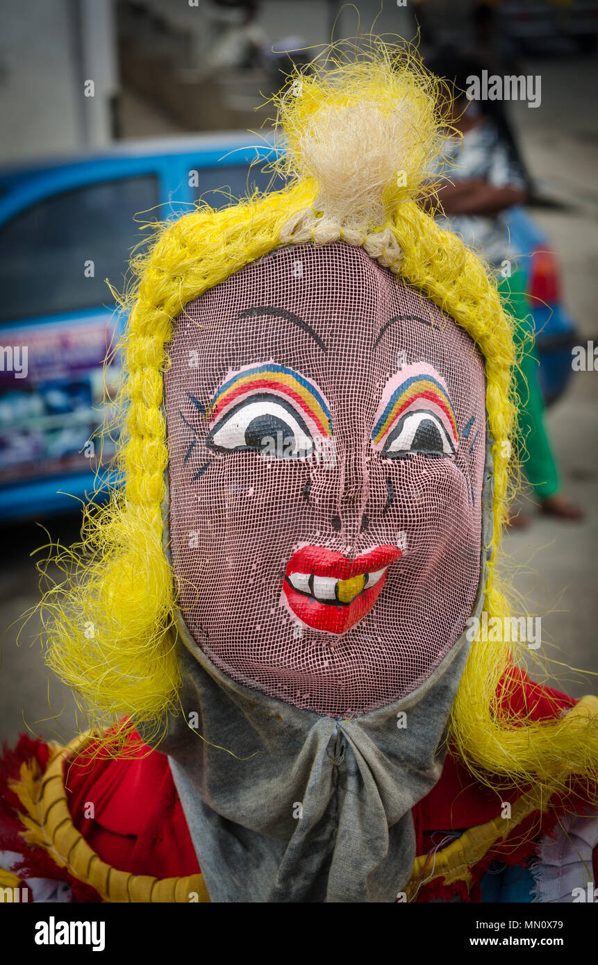 Cape Coast, Ghana - February 15, 2014: Colorful masked and costumed dancer during African carnival festivities - Stock Image