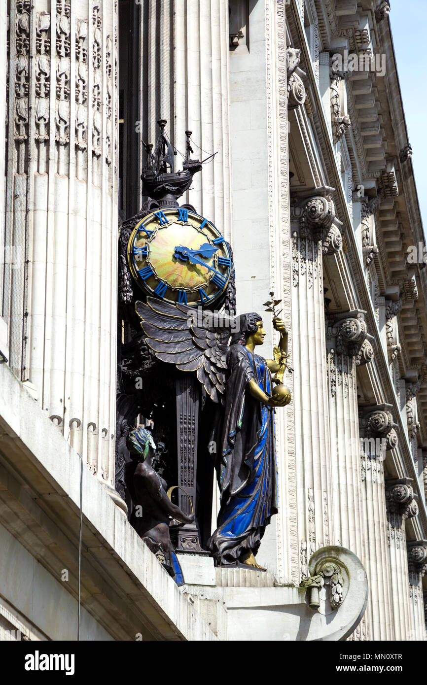 The Queen of Time clock bronze sculpture by Gilbert Bayes above the Selfridges entrance in Oxford Street, London, UK Stock Photo