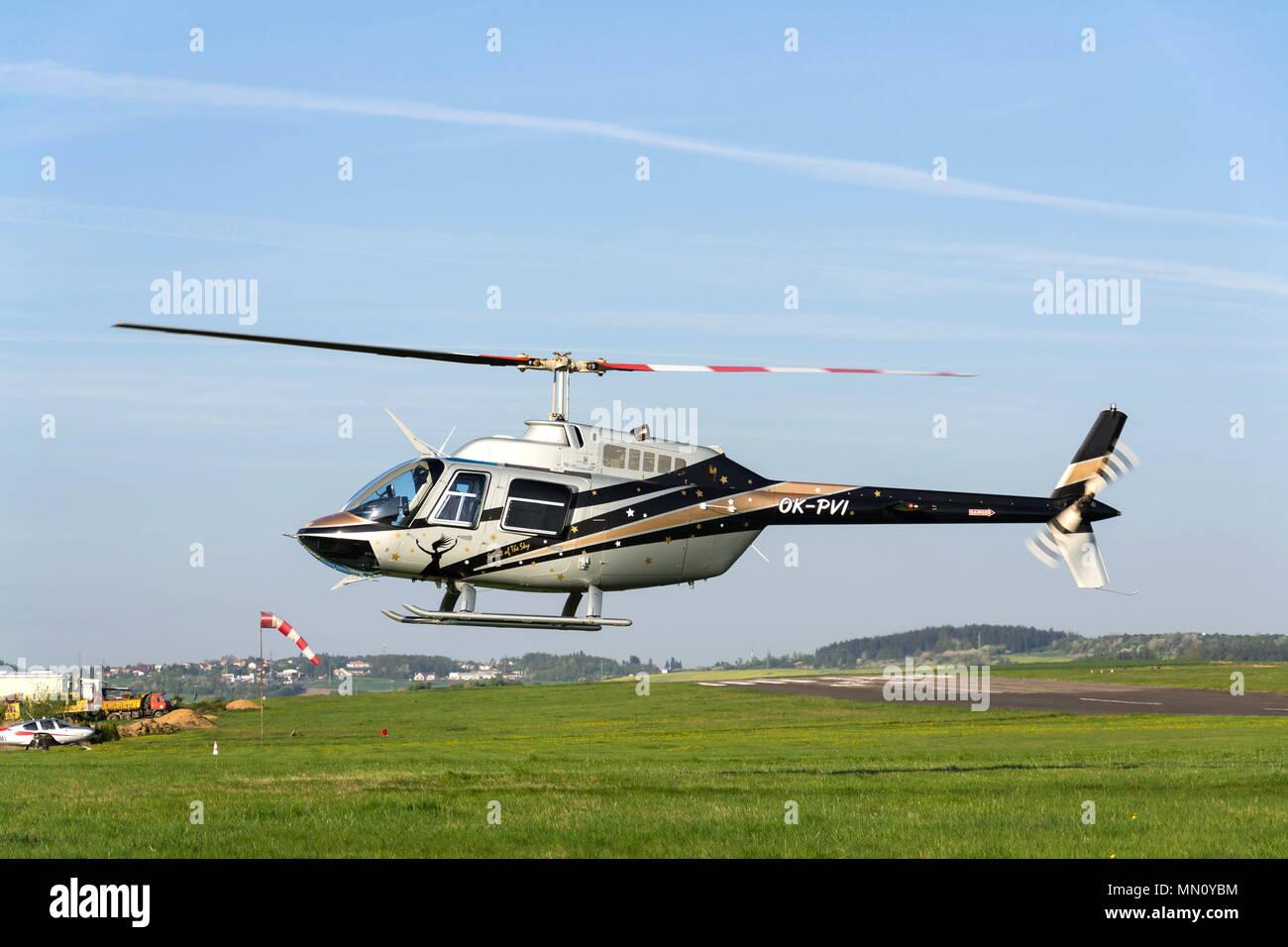 PRIBRAM, CZECH REPUBLIC - APRIL 25 2018: Bell 206 B JetRanger III two-bladed helicopter landing on April 25 2018 in Pribram, Czech Republic. - Stock Image