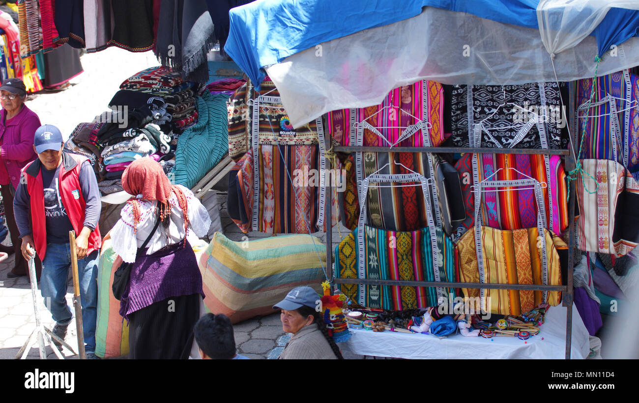 Indigenous woman selling her weavings and crafts in the Plaza de los Ponchos Stock Photo