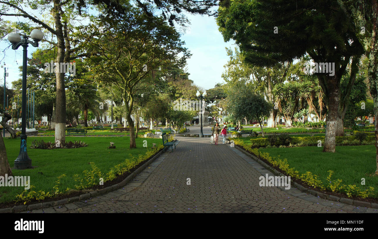 Women walking in Pedro Moncayo park. This park is next to the Ibarra Cathedral - Stock Image