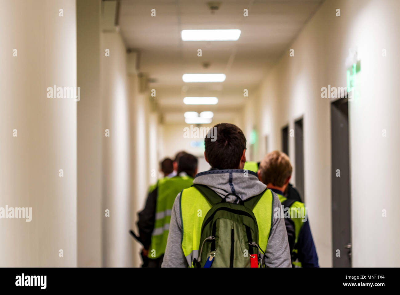 Back view of airport workers in uniform indoors - Stock Image