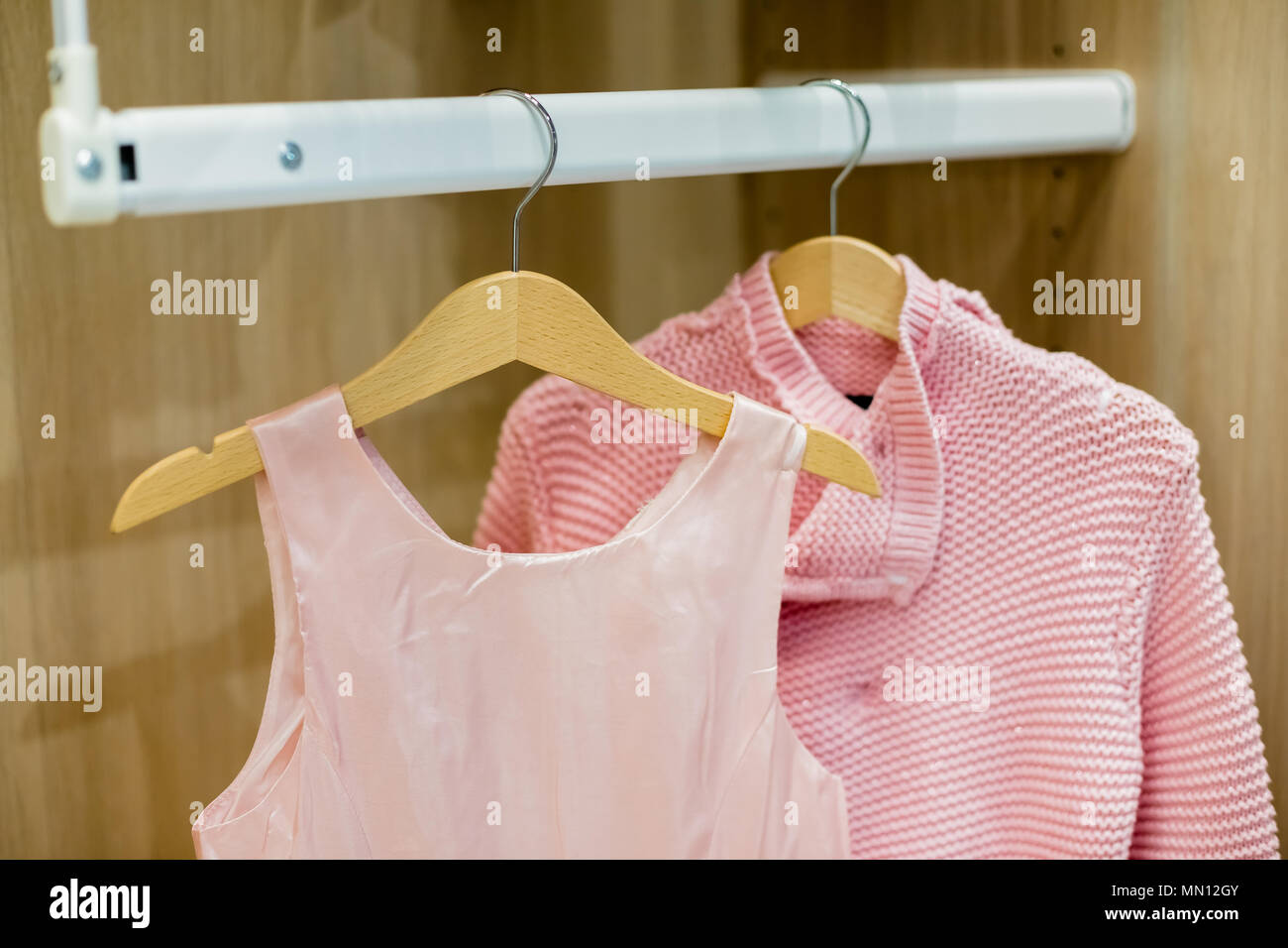 09c930366c69 A row of children clothes hanging on hangers. Fashion for girls ...