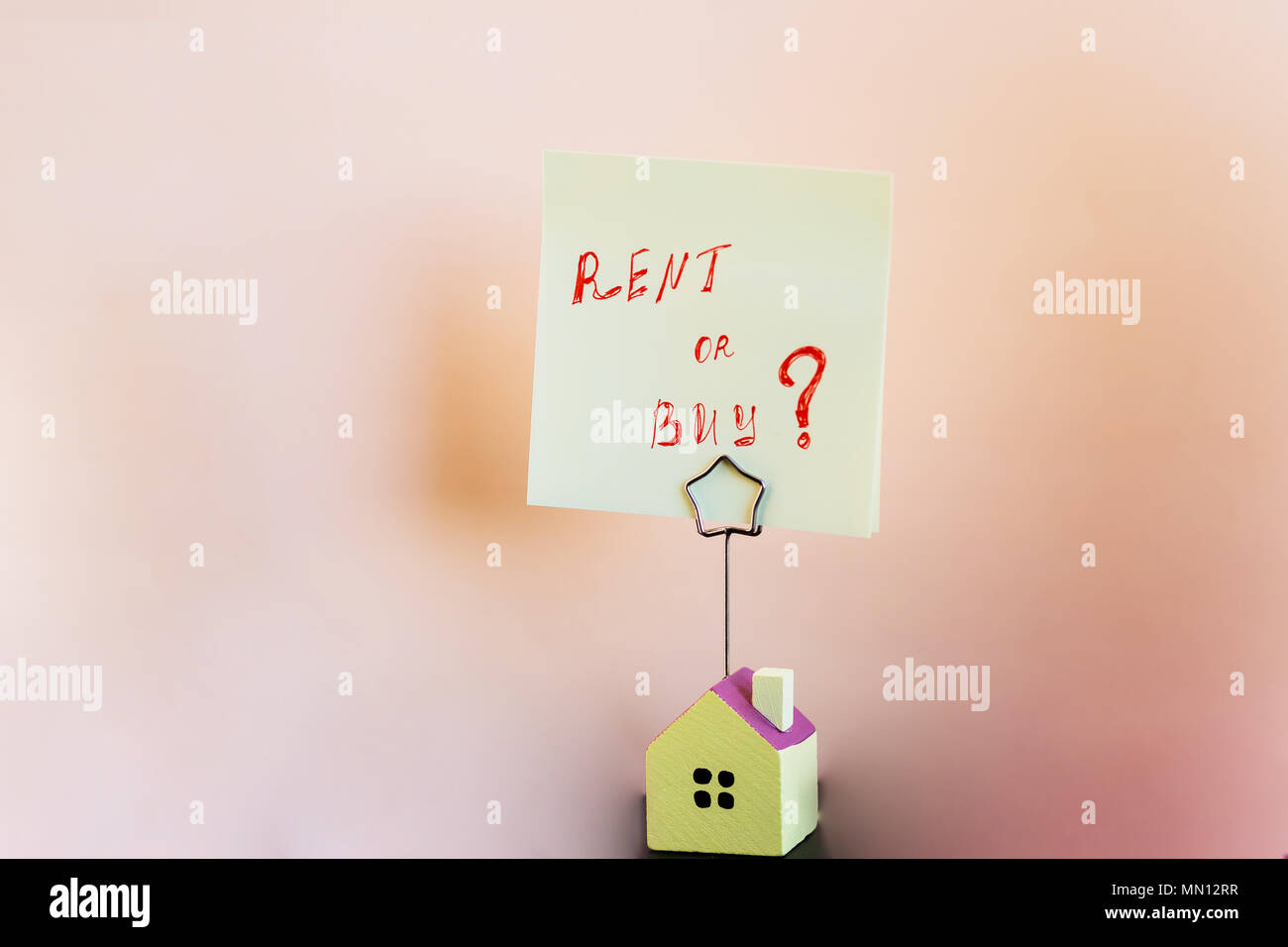 House for sale or rent a house. Concept real estate for sale.Rising house sales concept.yellow sticker with notes written with 'BUY OR RENT '.save a money - Stock Image
