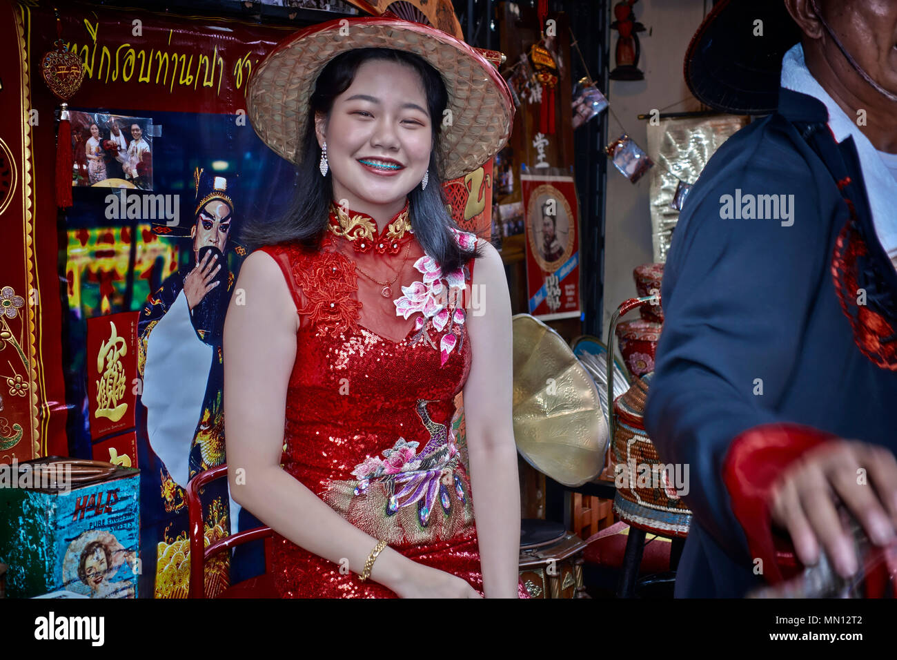 3598fca68 Stock Photo. Enlarge. China Town, Thailand, girl in traditional red Chinese  dress.