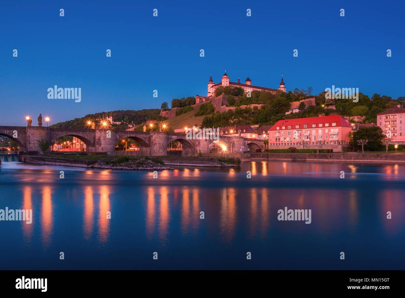 Beautiful stunning view of Wurzburg Old Main Bridge over the Main river and the Castle in the Old Town of Wurzburg, Bavaria, Germany - part of the Rom - Stock Image