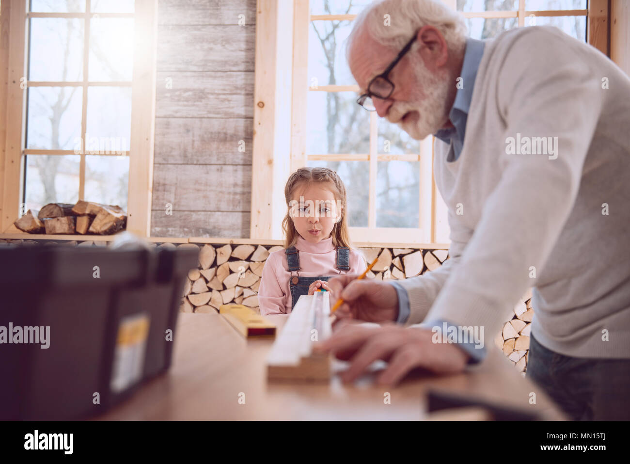 Serious smart girl being in the workshop - Stock Image