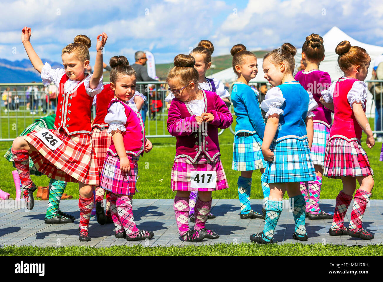 """Gourock, UK. 13th May 2018. Gourock starts off the """"Games"""" season with hundreds of pipers, """"heavies"""" and dancers from across the country, all competing in traditional Scottish Highland Games that include pipe bands, individual piping, country dancing for all ages and all the traditional heavyweight competitions such as tossing the caber, throwing the hammer and lifting the Keppoch Stone.Thousands of spectators turned out on a fine sunny May Sunday to cheer on all the competitors. Credit: Findlay/Alamy Live News Stock Photo"""