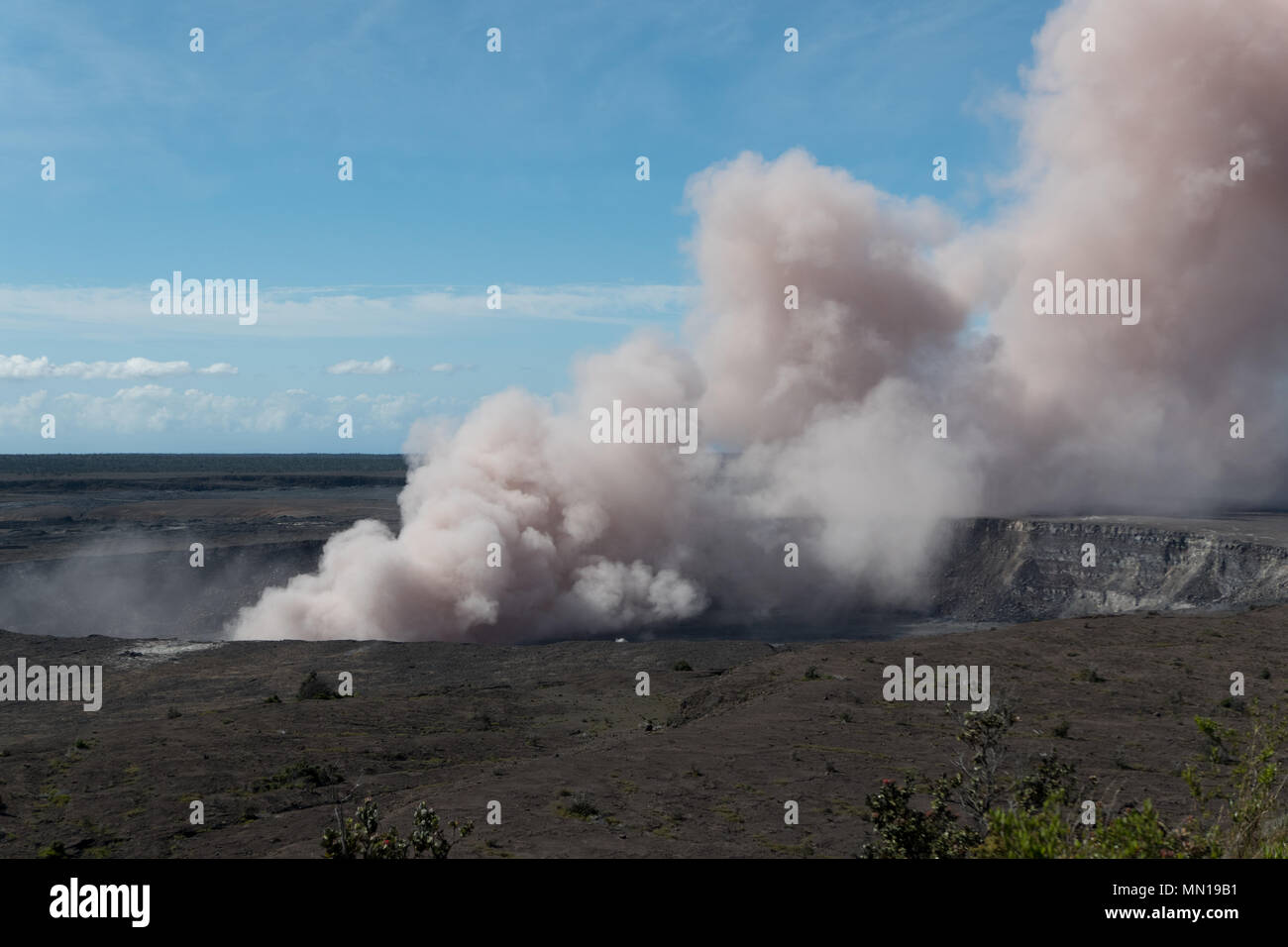 Hawaii, USA 12th May 2018. A grey ash plume rises from the Kilauea volcano May 11, 2018 in Hawaii. The recent eruption continues destroying homes, forcing evacuations and spewing lava and poison gas on the Big Island of Hawaii. Credit: Planetpix/Alamy Live NewsStock Photo