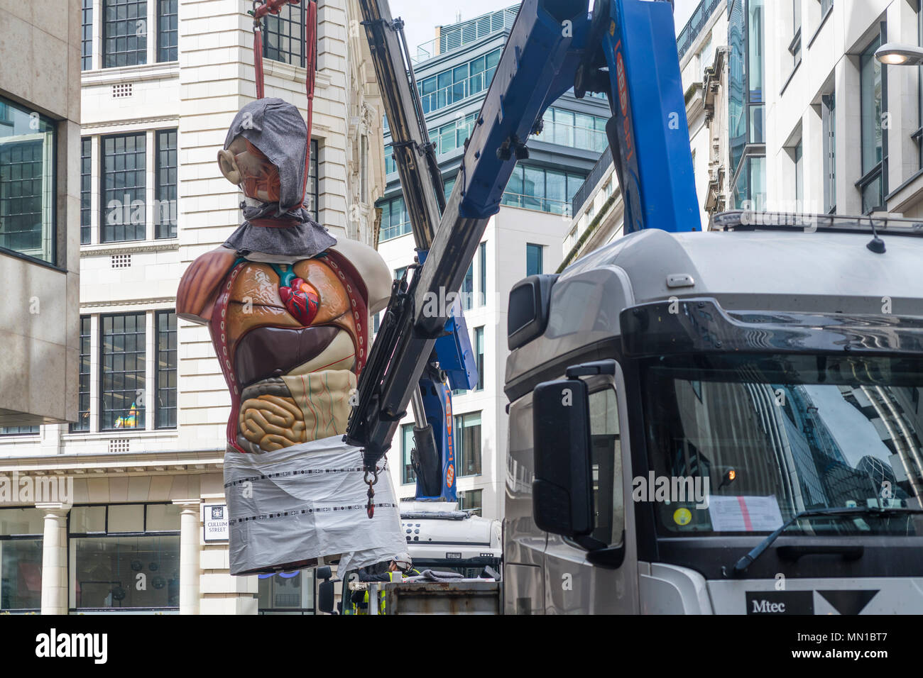 London, UK. 13th May, 2018. Damien Hirst's 'Temple' (2008) is being removed using a crane. The bronze sculpture was displayed in the City of London as part of Sculpture in the City until May 13, 2018 Credit: michelmond/Alamy Live News Stock Photo