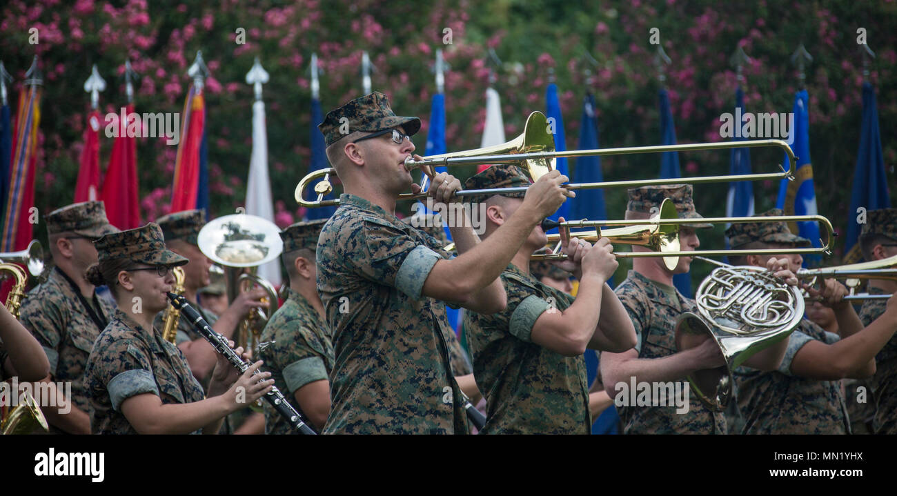 U.S. Marines with the 2d Marine Division Band perform during the U.S. Marine Corps Forces Command change of command ceremony, Naval Support Activity Hampton Roads, Norfolk, Va., Aug. 14, 2017. Lt. Gen. John E. Wissler relinquished his command to Lt. Gen. Mark A. Brilakis. (U.S. Marine Corps photo by Cpl. Samantha K. Braun) Stock Photo
