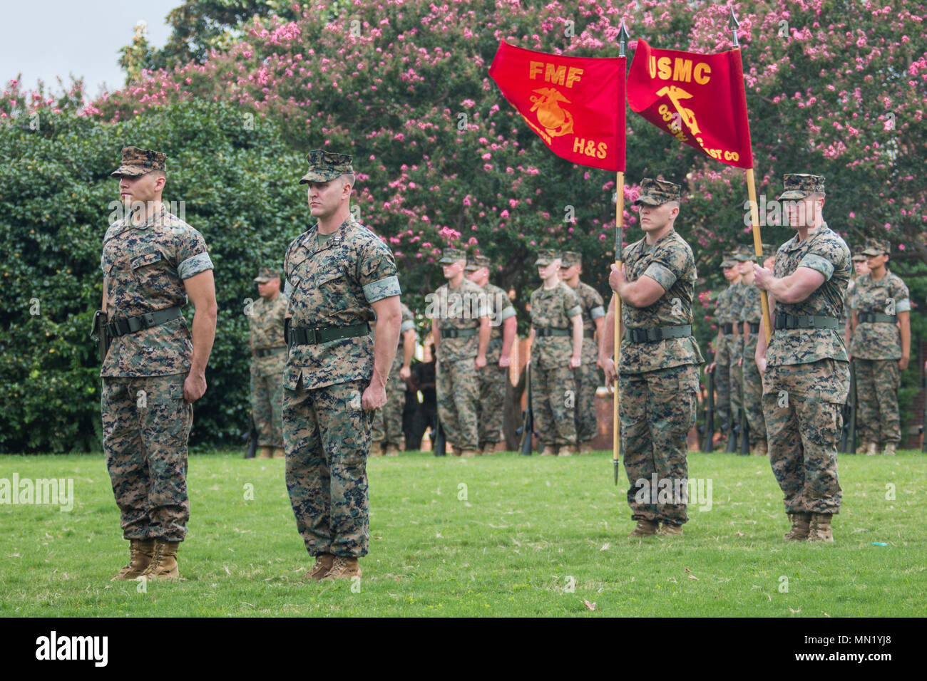 U.S. Marines with U.S. Marine Corps Forces Command stand at the position of attention during a change of command ceremony, Naval Support Activity Hampton Roads, Norfolk, Va., Aug. 14, 2017. Lt. Gen. John E. Wissler relinquished his command to Lt. Gen. Mark A. Brilakis. (U.S. Marine Corps photo by Cpl. Samantha K. Braun) Stock Photo
