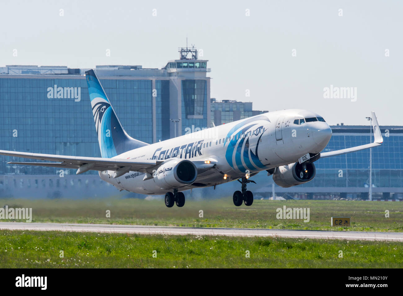 Boeing 737-800, two engine short- to medium-range, narrow-body jet airliner from EgyptAir, Egyptian airline taking off from runway - Stock Image